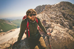 Man Traveler bearded with backpack relaxing. Travel Lifestyle concept mountains on background Summer vacations activity outdoor royalty free stock photography