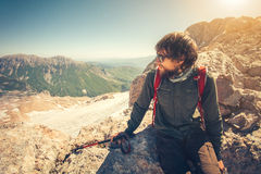 Man Traveler bearded with backpack relaxing. Travel Lifestyle concept mountains on background Summer vacations activity outdoor stock images