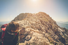 Man Traveler bearded with backpack relaxing Travel. Lifestyle concept mountains on background Summer vacations activity outdoor stock image
