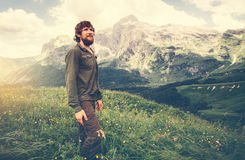 Man Traveler bearded walking outdoor Travel Lifestyle. Concept beautiful mountains landscape on background Summer journey adventure vacations royalty free stock photography