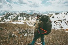 Man traveler with big backpack hiking in mountains Royalty Free Stock Images