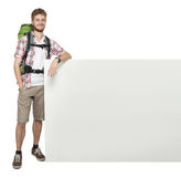 Man traveler with blank space board poster Stock Photo
