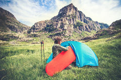 Man Traveler with camping equipment mat and tent outdoor Travel Lifestyle Stock Photo