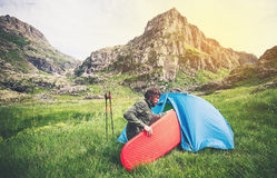 Man Traveler with camping equipment mattress and tent outdoor Travel Lifestyle Royalty Free Stock Photography
