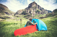 Man Traveler with camping equipment mattress and tent outdoor Stock Images