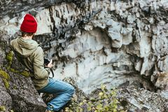 Man traveler climbing rocky mountains Travel lifestyle. Concept survival into the wild vacations Stock Image