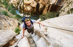 Free Man Traveler Climbing Up A Stepped Mountain Road. Spain Royalty Free Stock Photo - 91504755