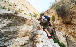 Man traveler climbing up a stepped mountain road. Spain royalty free stock images