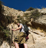 Man traveler climbing up a stepped mountain road. Spain stock photography