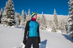 Man, traveler enjoying life in the winter mountains Stock Photos