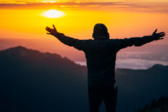 Man Traveler hands raised silhouette outdoor Stock Photography