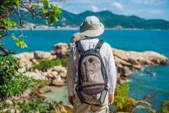 Man traveler look at Hon Chong cape, Garden stone, popular tourist destinations at Nha Trang. Vietnam. Asia Travel concept. Journey through Vietnam Concept Stock Image