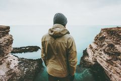 Man traveler looking at cold sea view alone Royalty Free Stock Images