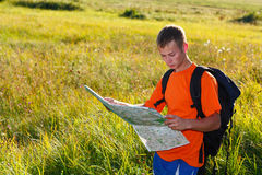 Man traveler with map in hand Stock Photos