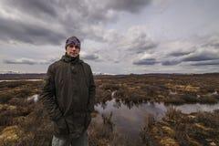 Man traveler on marshland Royalty Free Stock Photos
