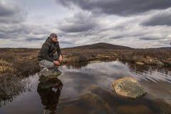 Man traveler on marshland Stock Photography