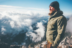 Man Traveler on mountain summit with clouds around Stock Photography