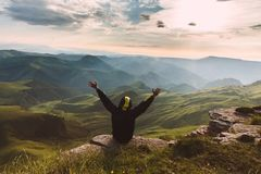 Man Traveler on mountain summit enjoying aerial view hands raised Travel Lifestyle success concept adventure active vacations. Outdoor happiness freedom royalty free stock images