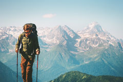 Man Traveler at mountains hiking with backpack. Travel Lifestyle concept adventure outdoor rocky mountains landscape on background Royalty Free Stock Images