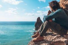 Man traveler over cold sea landscape Royalty Free Stock Image