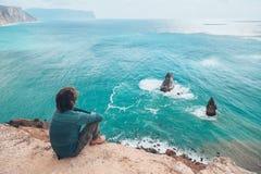 Man traveler over cold sea landscape Royalty Free Stock Images