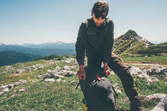 Man traveler packing backpack hiking in mountains Royalty Free Stock Photo