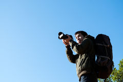 Man Traveler with photo camera and backpack Stock Images