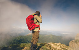 Man Traveler with photo camera and backpack hiking Royalty Free Stock Photo