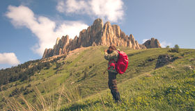 Man Traveler with photo camera and backpack hiking royalty free stock images