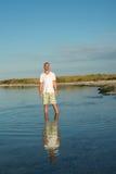 Man traveler relaxes in wild of seaside Stock Images