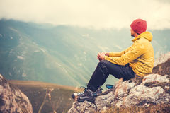 Man Traveler relaxing alone in Mountains Travel Lifestyle. Concept cloudy nature landscape on background Royalty Free Stock Images