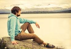 Man Traveler relaxing alone outdoor Lifestyle Travel Stock Image