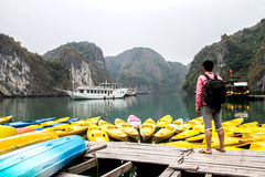 Man traveler relaxing meditation in halong bay and enjoy the beauty of seascape and mountain royalty free stock photos