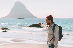 Man traveler relaxing on ocean beach enjoying landscape stock image
