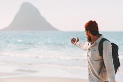Man traveler showing sea landscape beach traveling royalty free stock image