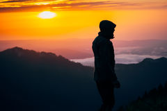 Man Traveler silhouette standing alone outdoor Stock Images