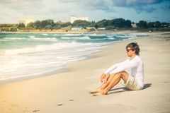 Man Traveler sitting on beach seaside Royalty Free Stock Photography