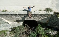 Man traveler sitting on a edge of the dam stock photos