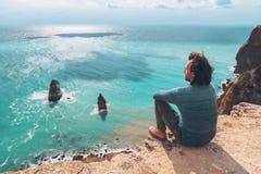 Man traveler over cold sea landscape Stock Images