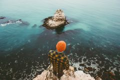 Man traveler standing on cliff above sea aerial view. Alone Travel Lifestyle concept adventure vacations outdoor Melancholy solitude emotions Royalty Free Stock Photography