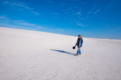 Man traveler, tired after a hard day, walks through the desert. Royalty Free Stock Image