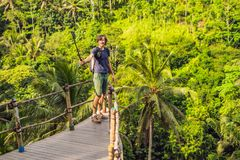 Man traveler on view point in the background of a jungle, Bali, Indonesia.  royalty free stock images