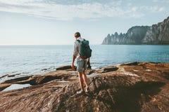 Man traveler walking alone on beach traveling vacations in Norway. Lifestyle outdoor Okshornan peaks landscape royalty free stock image