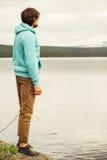 Man Traveler walking alone outdoor Lifestyle Travel Stock Photo