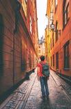 Man traveler walking alone in Stockholm narrow street royalty free stock photography
