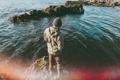 Man traveler walking at cold sea alone Royalty Free Stock Image