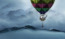 Man traveling in aerostat . Mixed media stock images
