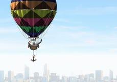 Man traveling in aerostat . Mixed media royalty free stock photos