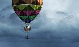 Man traveling in aerostat . Mixed media royalty free stock image