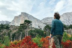 Man traveling in autumn forest by the mountain Royalty Free Stock Photography
